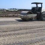 A smooth drum roller is utilized to finish the subgrade and provide a sealed surface.